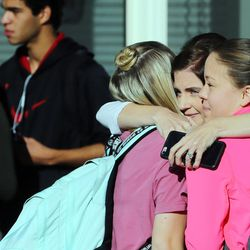 Susan Olson hugs her daughter, Alyssa, and friend Emma Nielsen as parents arrive at Mountain View High School in Orem to pick up their children after five students were stabbed in an apparent attack by a 16-year-old boy on Tuesday, Nov. 15, 2016.