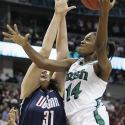 Connecticut center Stefanie Dolson (31) defends against Notre Dame forward Devereaux Peters (14) during the first half of the NCAA women's Final Four semifinal college basketball game, in Denver, Sunday, April 1, 2012.