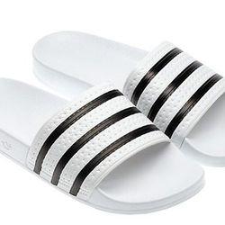 """<b>Adidas</b> Adilette Slides, <a href=""""http://www.adidas.com/us/product/originals-adilette-slides/34725?cid=280648&breadcrumb=1z13071Z1z11zrfZu3Z1z13xep"""">$30</a>"""