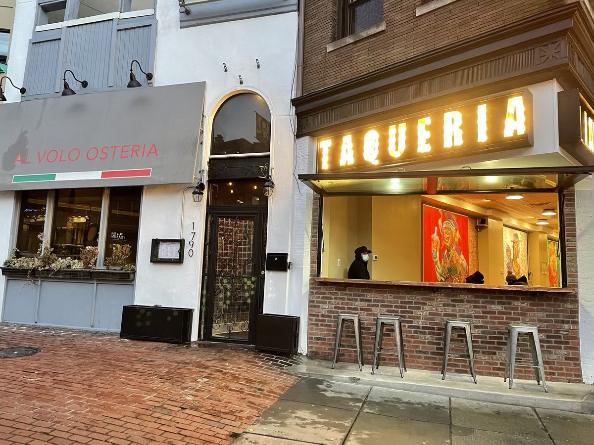 A large front window airs out the space at Taqueria al Lado