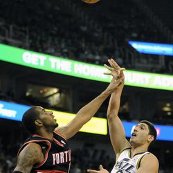 Utah Jazz center Enes Kanter (0) shoots over the arm of Portland Trail Blazers center LaMarcus Aldridge (12) in the second half of a game at the Energy Solutions Arena on Wednesday, October 16, 2013.