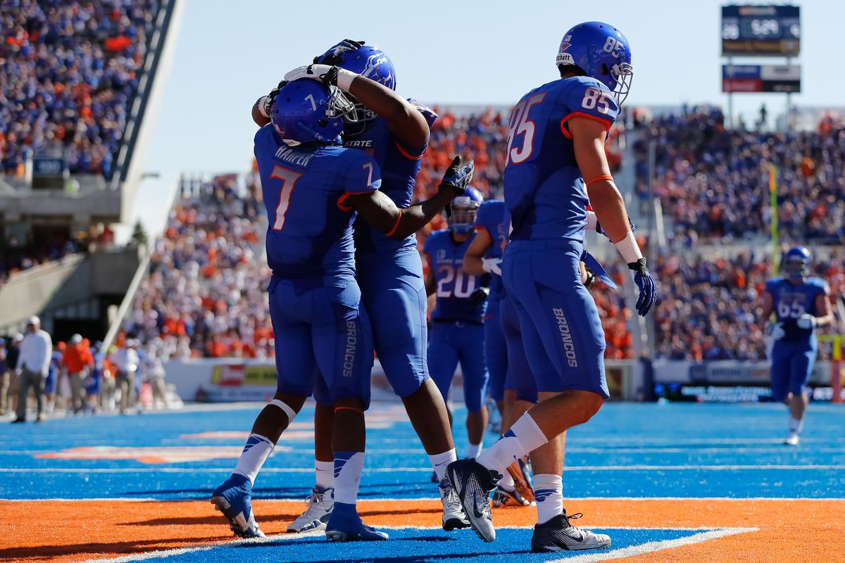 BOISE, ID - SEPTEMBER 15:  The Boise State Broncos celebrate a touchdown against the Miami University RedHawks at Bronco Stadium on September 15, 2012 in Boise, Idaho.  (Photo by Otto Kitsinger III/Getty Images)