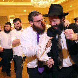 Nochum Greenwald and Rabbi Zalman Mendelsohn dance at a traditional Hasidic wedding at the Grand America Hotel in Salt Lake City on Monday, Sept. 12, 2016.