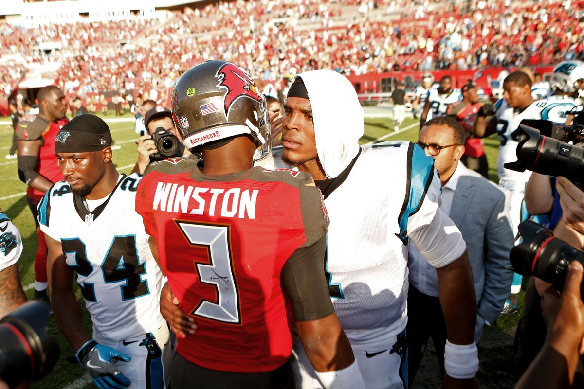 Quarterback Jameis Winston of the Tampa Bay Buccaneers speaks with quarterback Cam Newton of the Carolina Panthers following the Buccaneers' 17-16 win over the Panthers at an NFL game on January 1, 2017 at Raymond James Stadium in Tampa, Florida.