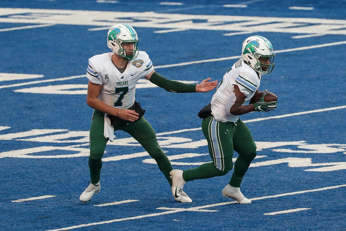 Quarterback Michael Pratt of the Tulane Green Wave hands the ball off to wide receiver Isaac Jernagin during second half action between the Nevada Wolf Pack at the Famous Idaho Potato Bowl at Albertsons Stadium on December 22, 2020 in Boise, Idaho.