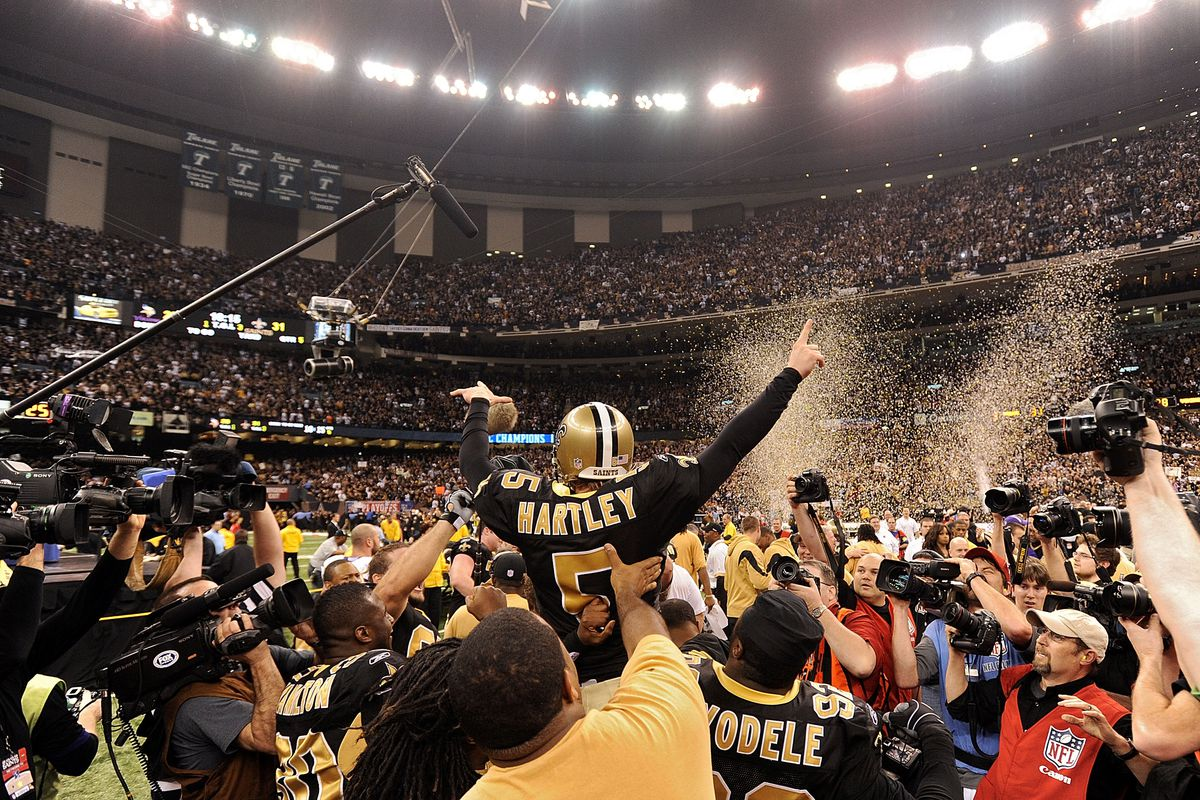 NEW ORLEANS, LA - New Orleans Saints kicker Garrett Hartley (5) is mobbed by teammates after hitting a gaming winning field goal in overtime against the Minnesota Vikings to win the 2009 NFC Championship Game  at the Louisiana Superdome.
