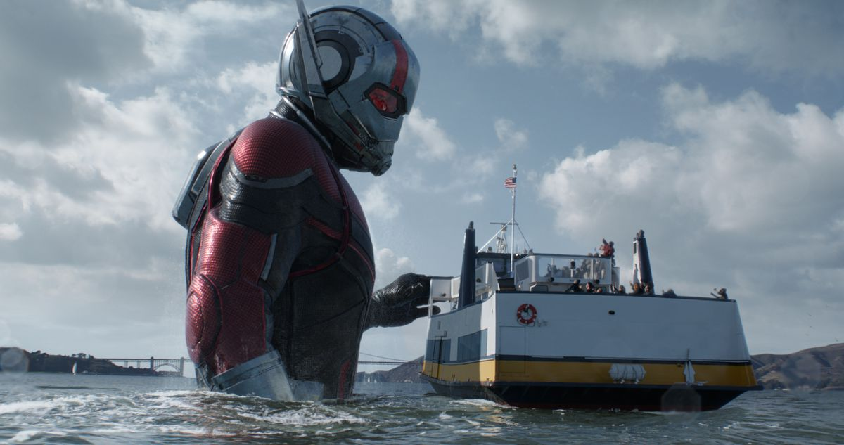 Ant-Man standing next to a tiny ship