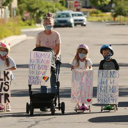 Brittany Cross walks down the street with her kids Georgia, Eli, Lucy and David as they join several hundred demonstrators who gathered to march for Black Lives Matter at Daybreak in South Jordan on Wednesday, June 17, 2020.