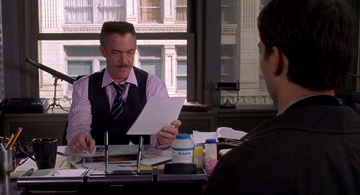 J.K. Simmons, looking angry, as J. Jonah Jameson.