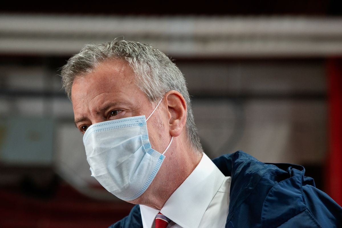 A close-up shot of NYC Mayor Bill de Blasio wearing a blue disposable face mask