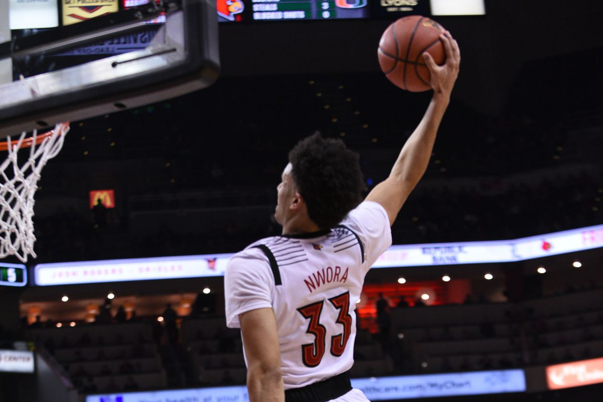 Jordan Nwora rises for a monster dunk in the blowout win over Miami.