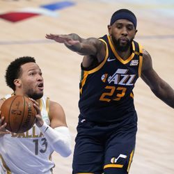 Dallas Mavericks guard Jalen Brunson (13) drives past Utah Jazz forward Royce O'Neale (23) for a shot opportunity in the second half of an NBA basketball game in Dallas, Monday, April 5, 2021.