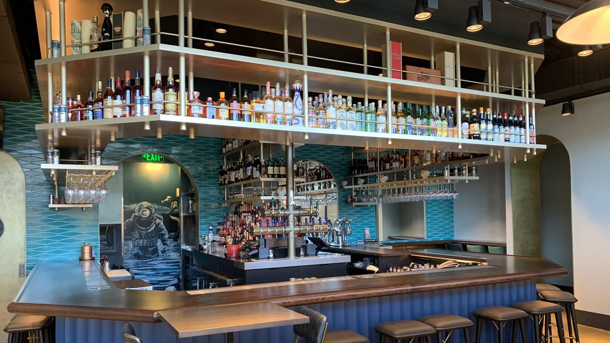 The bar at Nautilus Pier 4, which is designed to look like its on a yacht. It is made from walnut and have massive, floating shelves.