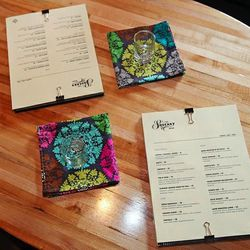 Each menu is clipped to a vintage cookbook, and each napkin was handmade by Steve Gallic's wife.