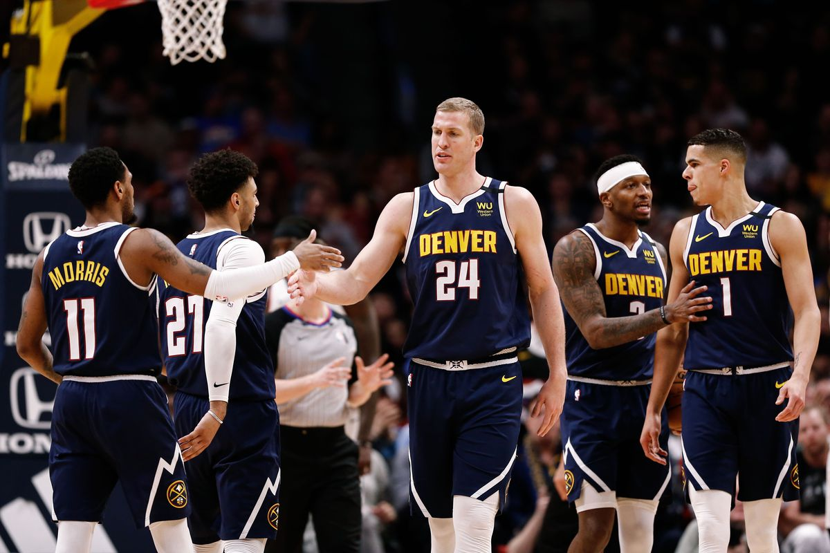 Denver Nuggets forward Mason Plumlee reacts with guard Monte Morris ahead of guard Jamal Murray and forward Torrey Craig and forward Michael Porter Jr. in the fourth quarter against the Los Angeles Clippers at the Pepsi Center.