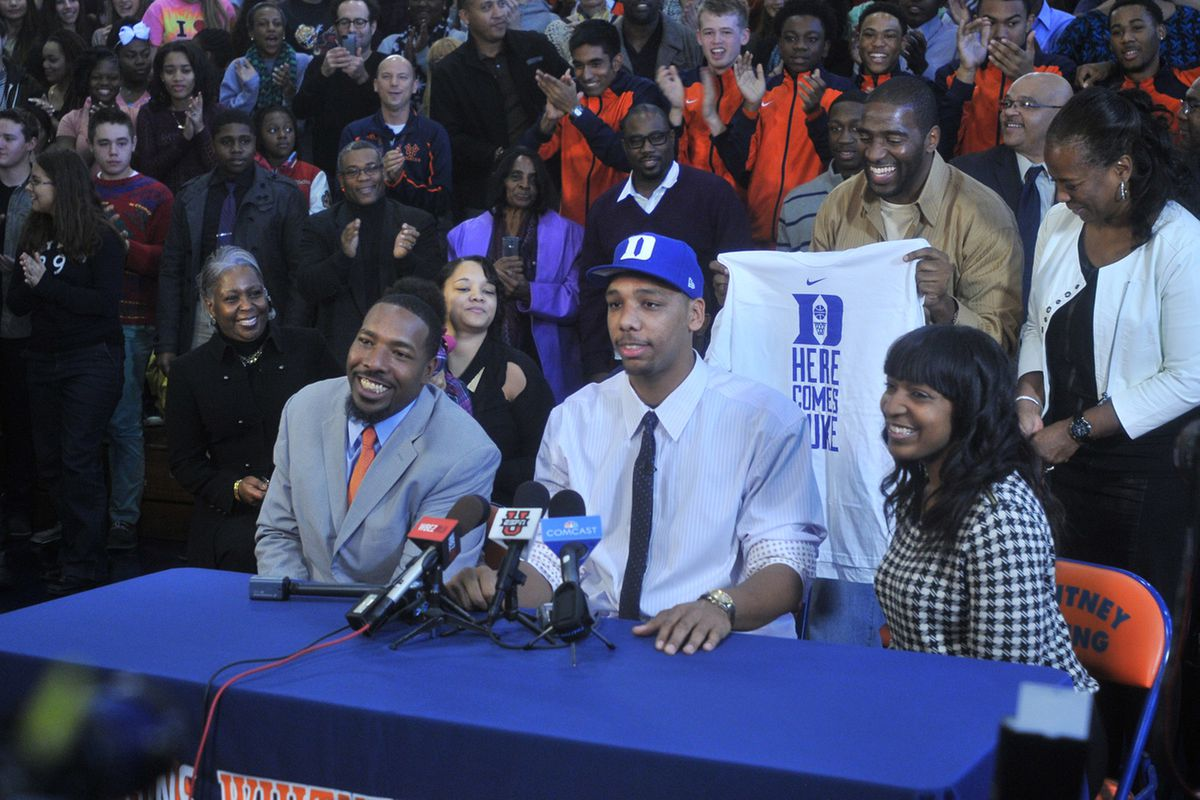 Young's Jahlil Okafor sits at the table with his father Chukwudi Okafor, and his aunt Dr. Chinyere Okafor Conley while he commits to Duke.