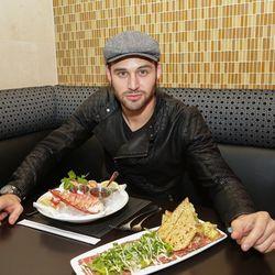 Ryan Guzman dines on a shellfish platter and New York sirloin carpaccio at N9NE Steakhouse. Photo: Edison Graff
