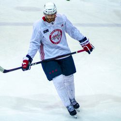 Nic Dowd looks on at Capitals morning skate.
