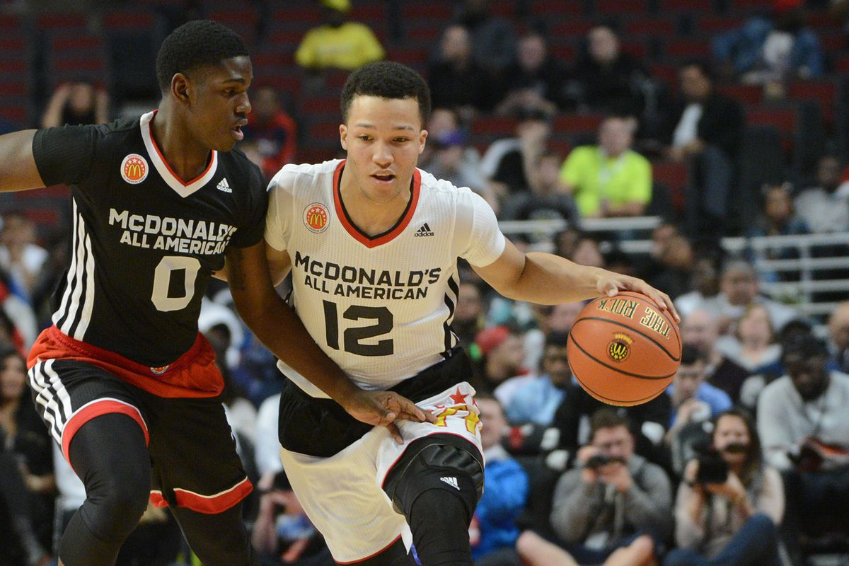 Jawun Evans (0) tries to take the ball from Jalen Brunson in the 2015 McDonald's All-American Game.