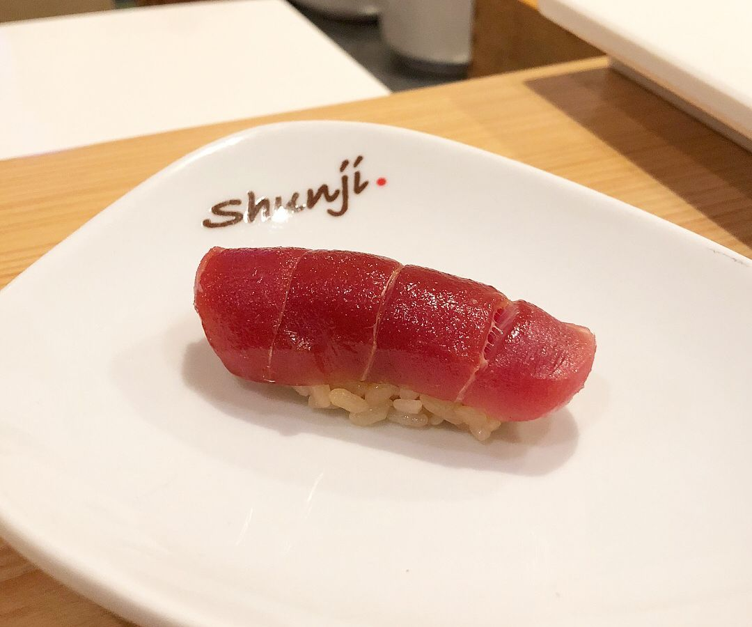 Shunji sushi on a plate bearing the restaurant's name.