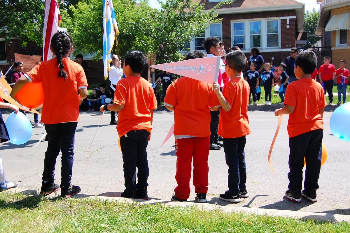 Students at Sandoval elementary take part in College Day, during which students hold a parade and learn about financial aid, in June 2019.