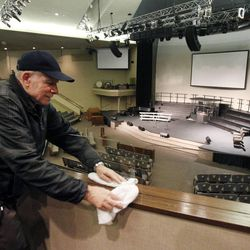 Leonid Zadniprovskiy cleans wood and glass at the Life Center Church sanctuary in Tacoma, Wash., Friday, Feb. 10, 2012 in preparation for the memorial for Susan Cox Powell, Charlie Powell and Braden Powell.