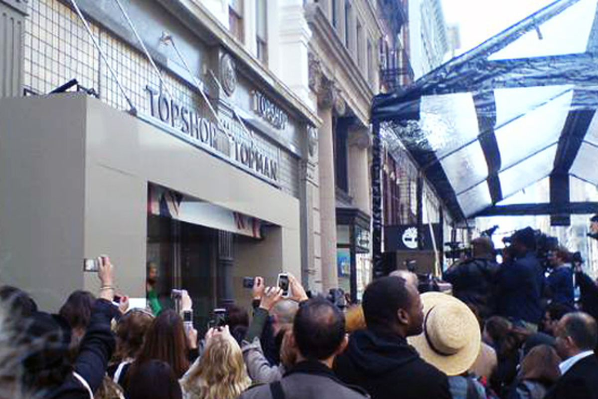 Crowds vie for a photo of Topshop on opening day