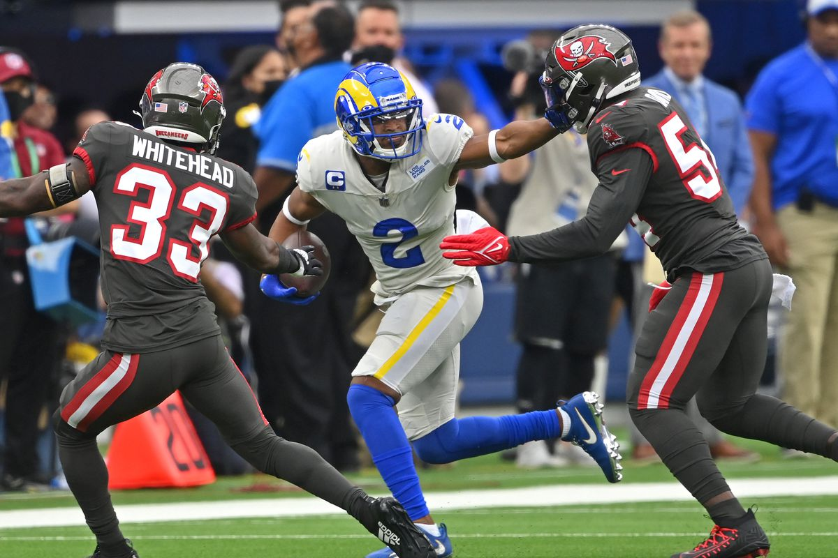 Los Angeles Rams wide receiver Robert Woods (2) is chased down by Tampa Bay Buccaneers free safety Jordan Whitehead (33) and outside linebacker Lavonte David (54) after a first down in the first half of the game at SoFi Stadium.