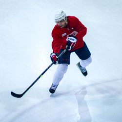 T.J. Oshie shoots the puck during Capitals morning skate.