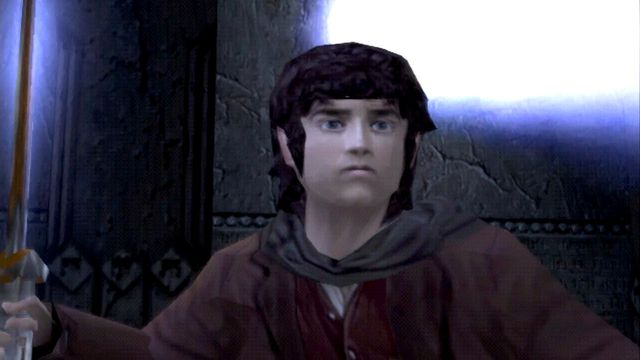 A blocky Frodo raises Sting in The Lord of the Rings: The Two Towers for the Playstation 2.