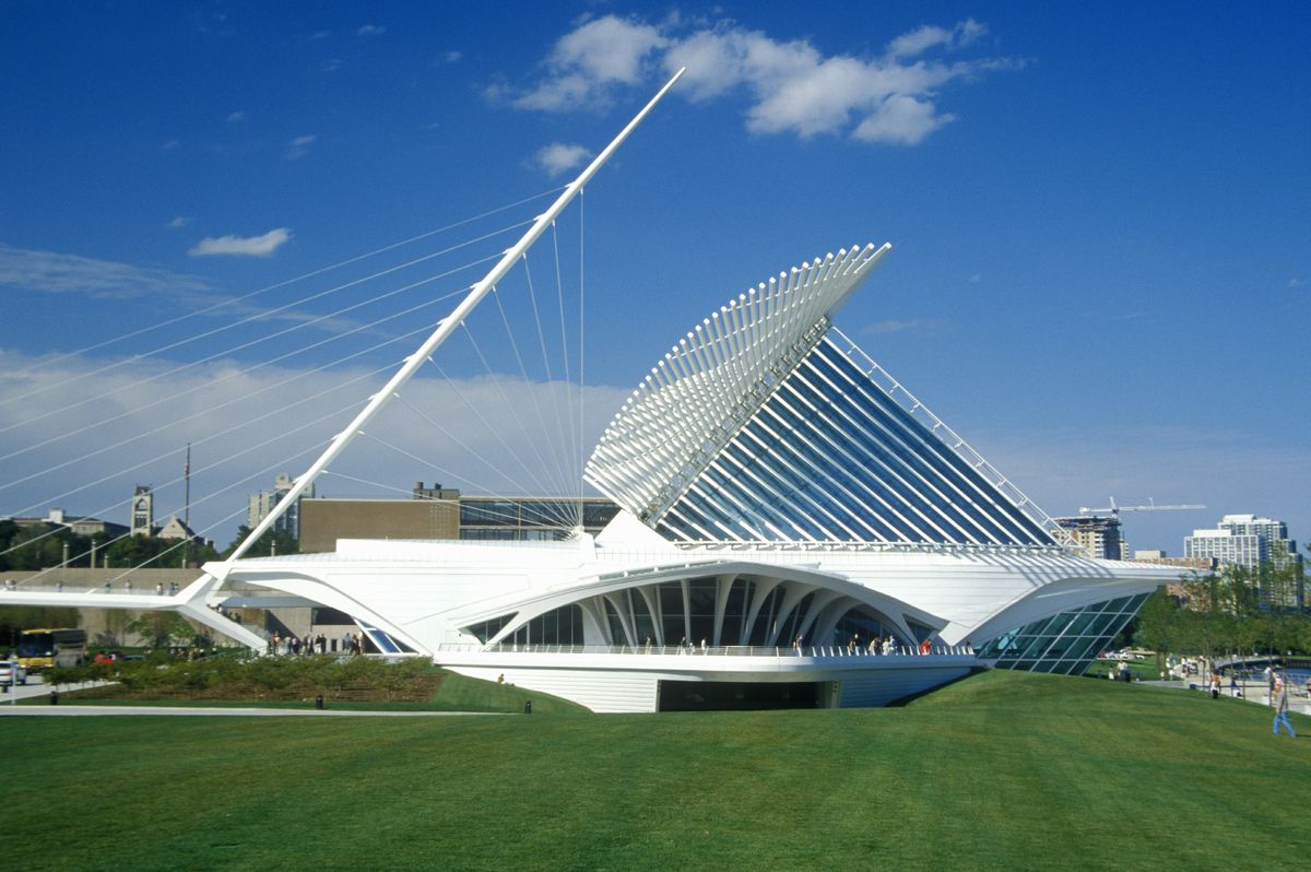 The exterior of the Milwaukee Art Museum in Wisconsin. The facade is white with an angular structure.