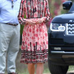In a Topshop smock dress while touring an Indian village on April 13th, 2016.
