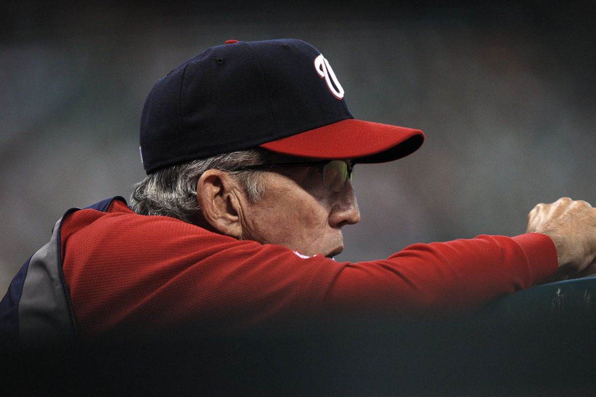 HOUSTON - JULY 19:  Manager Davey Johnston #5 of the Washington Nationals looks from the dugout during a basebal game against the Houston Astros at Minute Maid Park on July 19, 2011 in Houston, Texas.  (Photo by Bob Levey/Getty Images)
