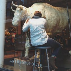 Only walking the New York streets would you see the secrets of fabulous shop windows. This is how a paper mâché bull gets his fur coat.