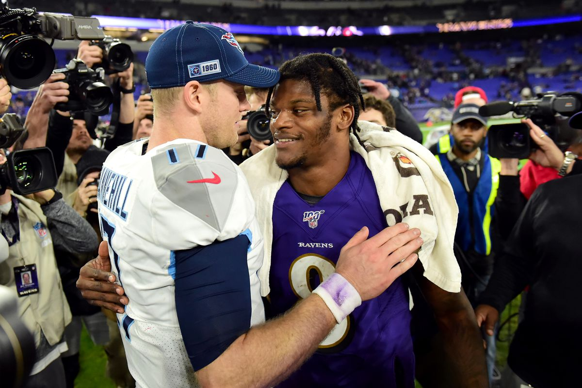 Tennessee Titans quarterback Ryan Tannehill (17) is congratulated by Baltimore Ravens quarterback Lamar Jackson (8) after the game in a AFC Divisional Round playoff football game at M&T Bank Stadium.