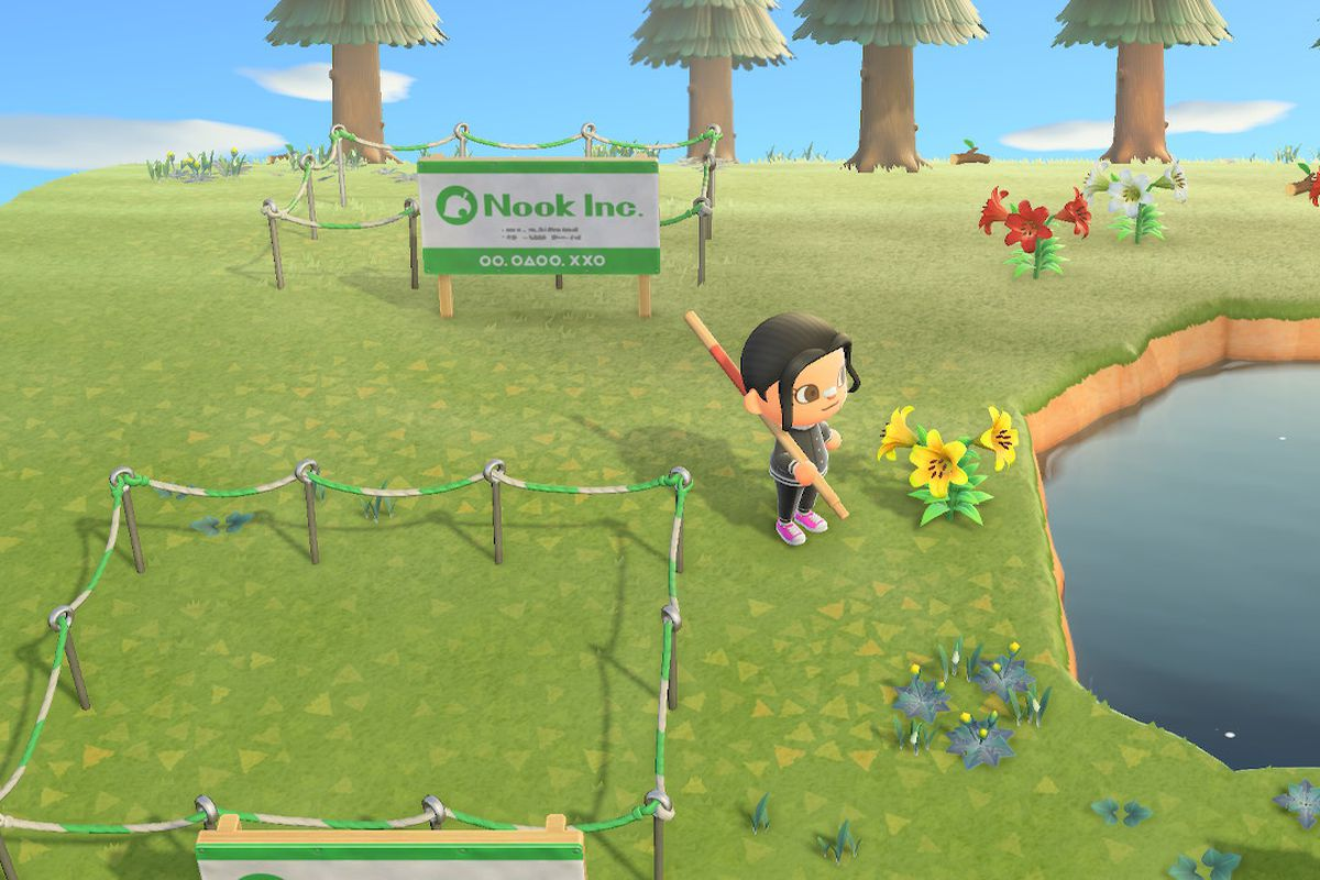 an Animal Crossing character stands in front of empty lots for sale on an island in Animal Crossing: New Horizons