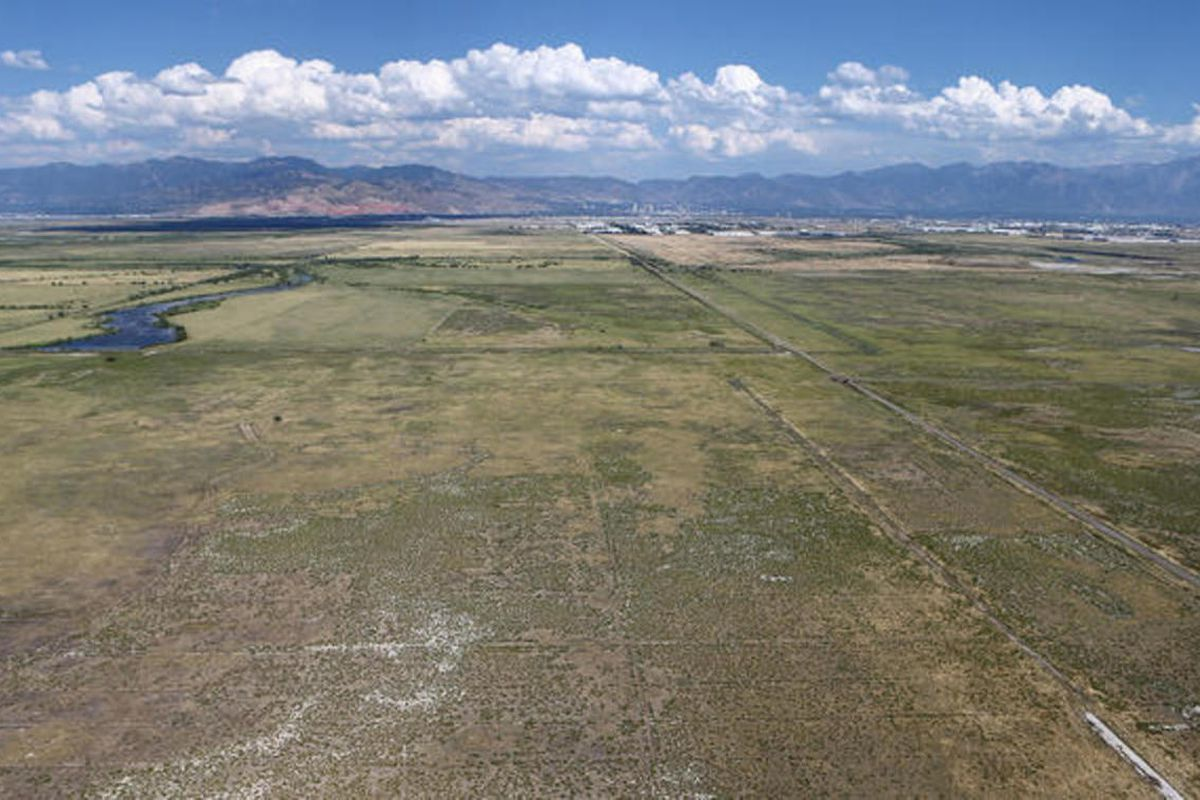 FILE — Looking northwest from the Utah State Prison possible relocation site about 7200 West, north of I-80 Aug. 10, 2015, in Salt Lake City. Nearly two months after their first meeting, members of the Prison Development Commission adopted recommendations