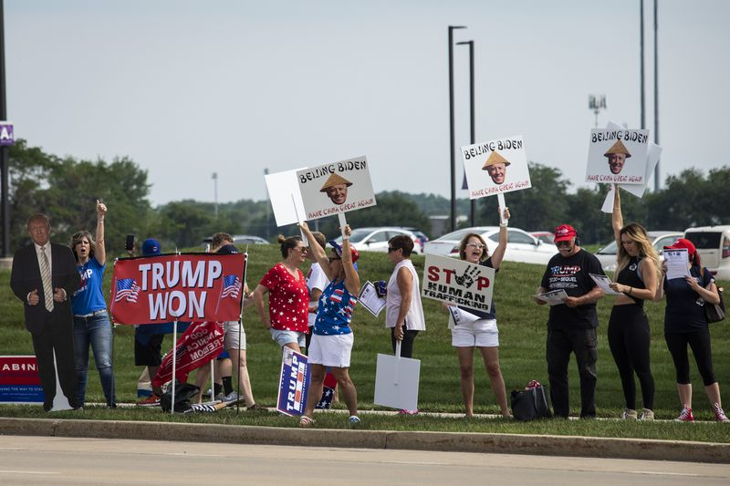 Supporters of former President Donald Trump rally outside McHenry County College on Wednesday.