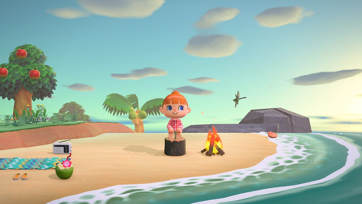 A human sitting on the beach wearing a red shirt in Animal Crossing: New Horizons