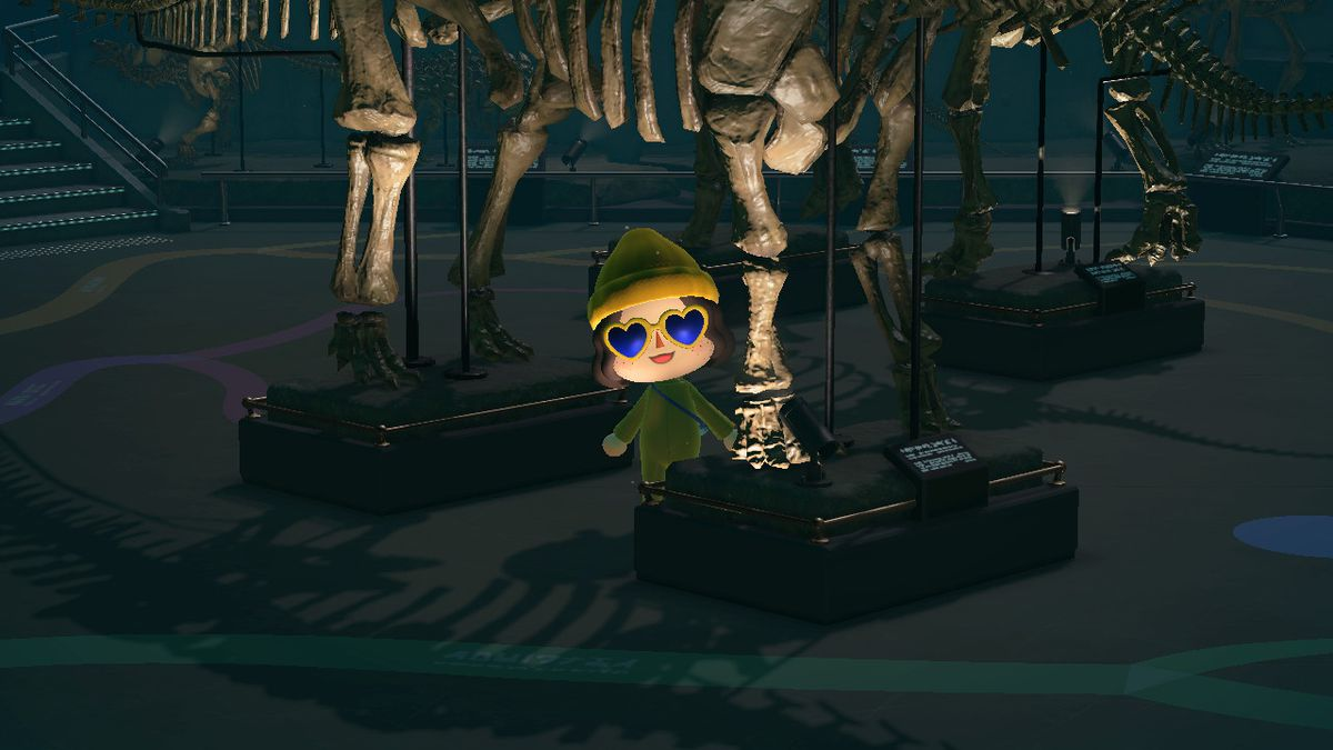 An animal crossing character standing under a dinosaur bones statue