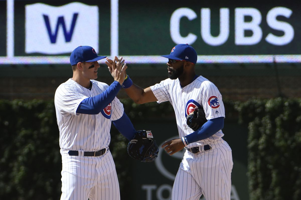 Jun 2, 2017; Chicago, IL, USA;  Chicago Cubs first baseman Anthony Rizzo (left) and right fielder Jason Heyward (22) celebrate their win against the St. Louis Cardinals at Wrigley Field. Mandatory Credit: David Banks-USA TODAY Sports