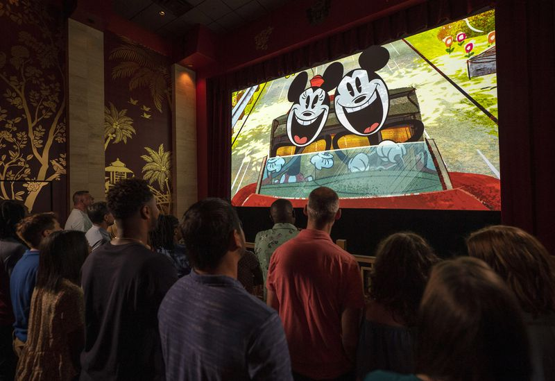 "Guests watch a new ""Mickey Mouse"" cartoon short, ""Perfect Picnic,"" to begin their Mickey & Minnie's Runaway Railway experience"