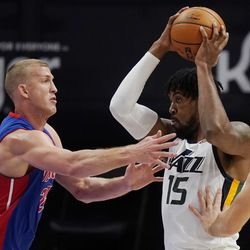 Utah Jazz center Derrick Favors (15) controls the ball as Detroit Pistons center Mason Plumlee (24) defends during the first half of an NBA basketball game, Sunday, Jan. 10, 2021, in Detroit.