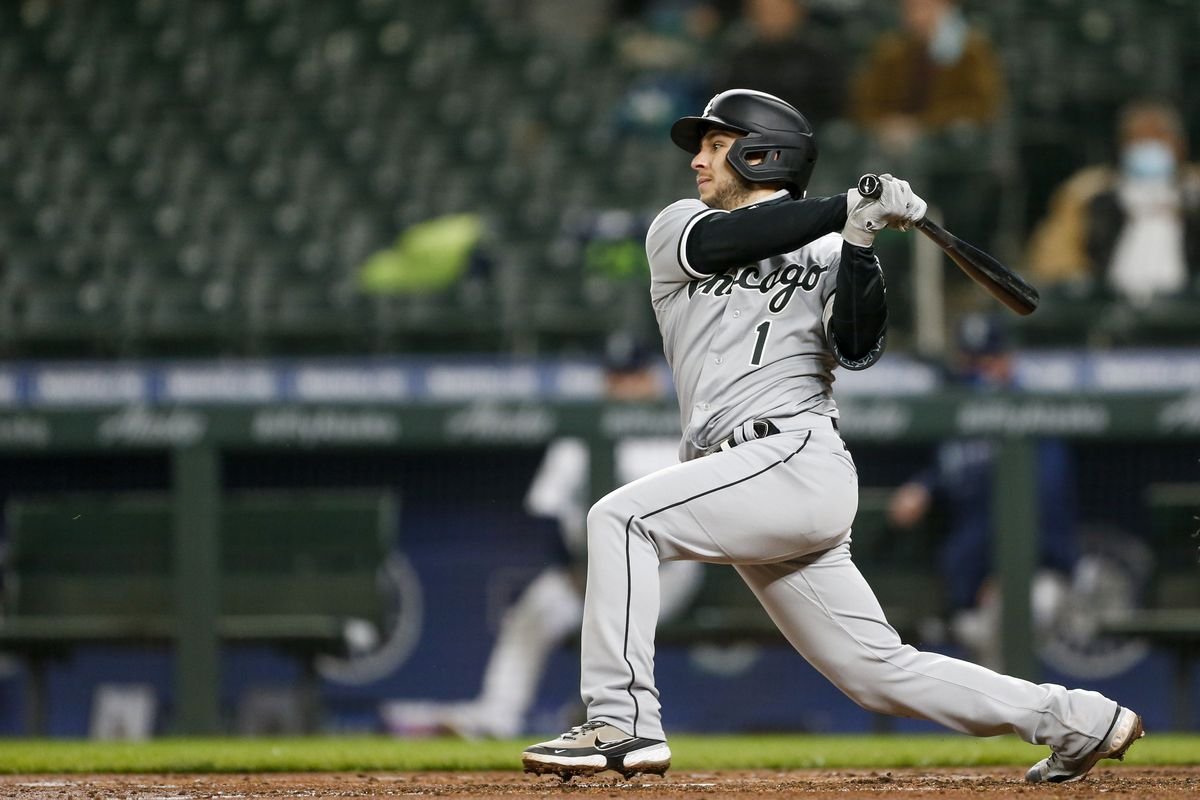 Chicago White Sox second baseman Nick Madrigal hits into an RBI double play against the Seattle Mariners during the fourth inning at T-Mobile Park.