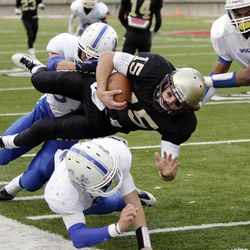 Lone Peak High School's Chase Hansen runs for big yardage against Fremont  in the 5A State Championship game in Salt Lake City  Friday, Nov. 18, 2011.