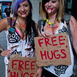 Adrienne Brynteson, left, and Nicole Willerson, both of Rome, Ga., dress as vampires,  at Dragon Con in Atlanta, on Friday, Aug. 31, 2012. The annual science fiction and fantasy convention drew big crowds and had more than 30,000 pre-registered attendees.