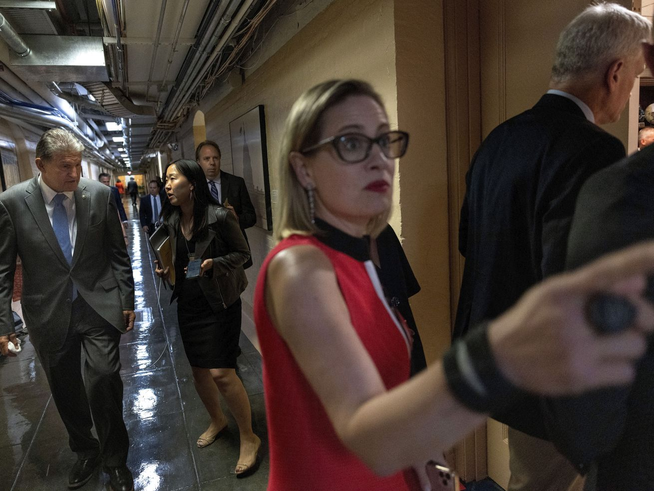 Sens. Kyrsten Sinema (D-AZ) (R) and Joe Manchin (D-WV) arrive for a bipartisan meeting on infrastructure after original talks fell through with the White House on June 08, 2021 in Washington, DC.