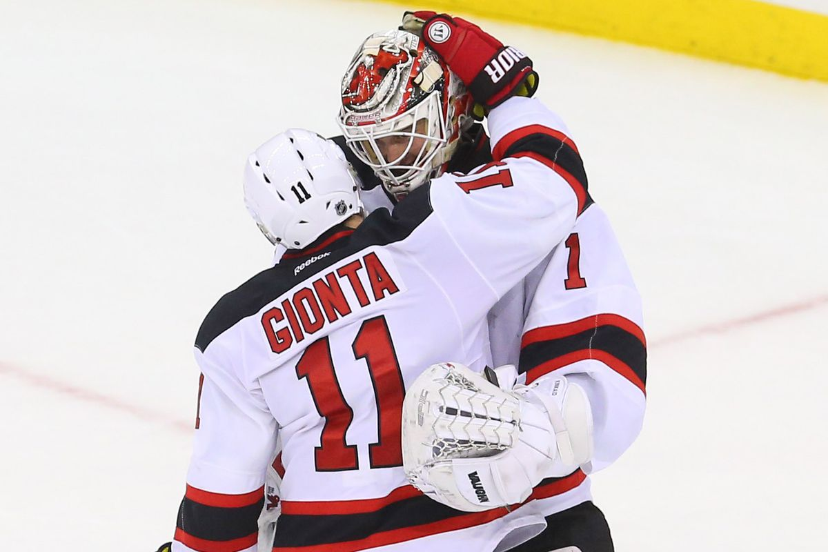 A happy moment between Stephen Gionta and Keith Kinkaid.