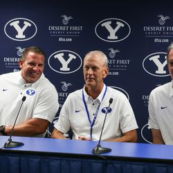 Luke Staley, Robbie Bosco and Marc Wilson, who played under the to-be-retired jersey No. 6, talk to journalists before the game against the Wisconsin Badgers at LaVell Edwards Stadium in Provo on Saturday, Sept. 16, 2017.