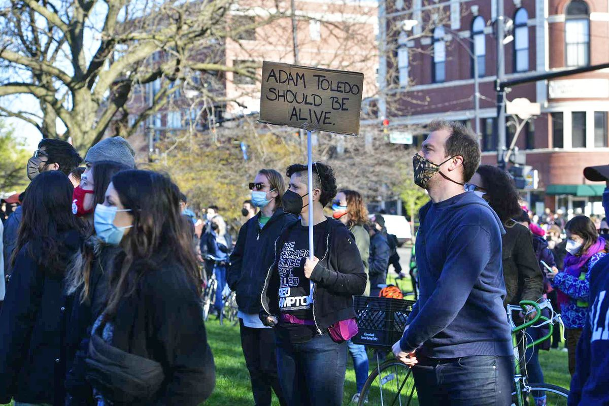 Hundreds packed into Logan Square Park on Friday, April 16, 2021 to protest the fatal shooting by Chicago police of 13-year-old Adam Toledo.